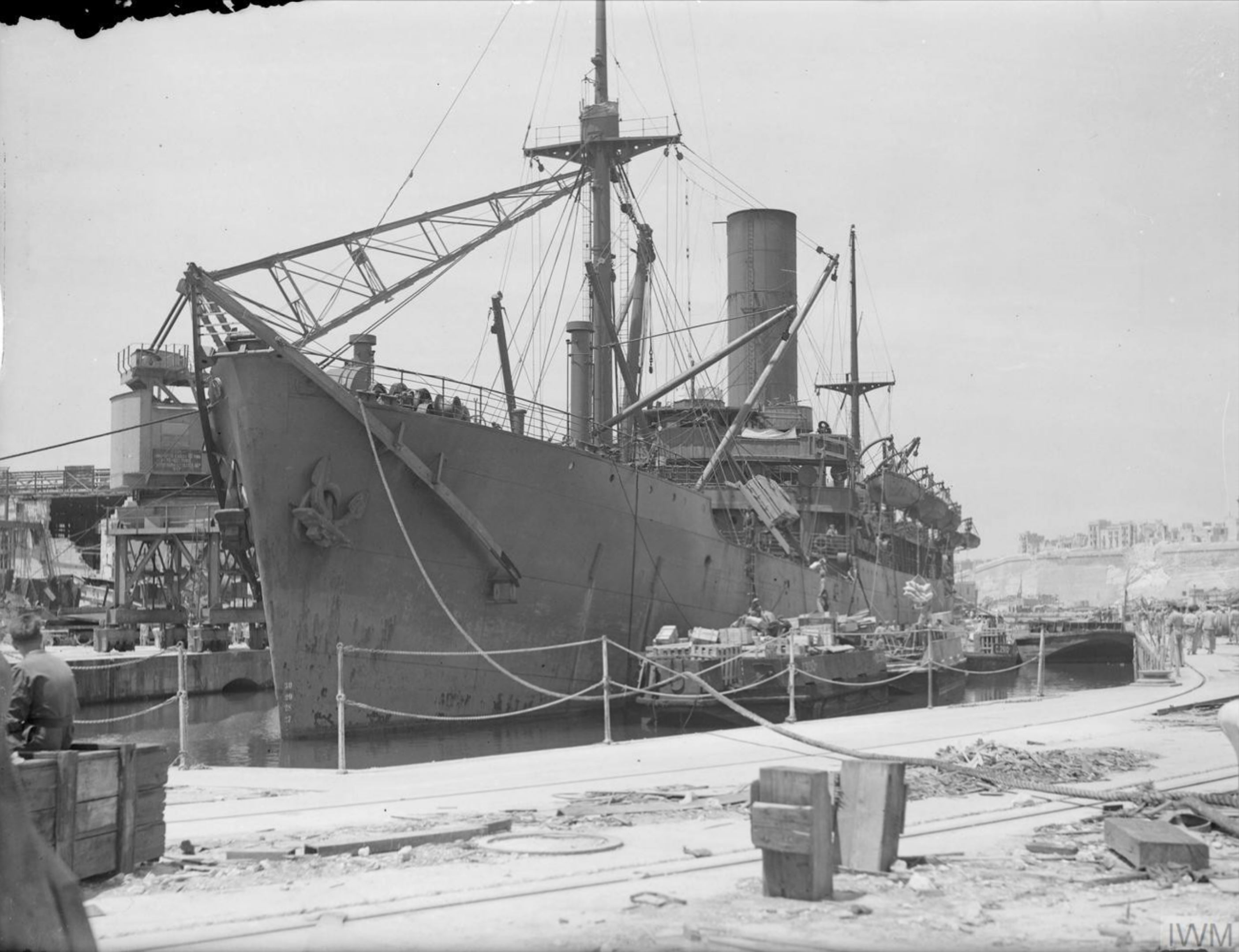 Merchant ship Troilus freight being emptied in Grand Harbour Malta 16th Jun 1942 IWM A10408