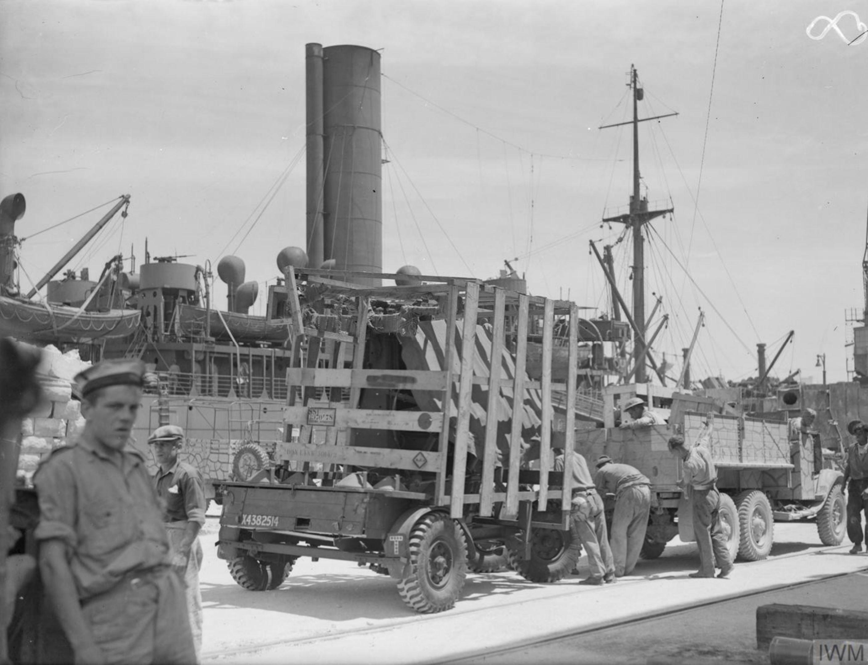Merchant ship Troilus freight being emptied in Grand Harbour Malta 16th Jun 1942 IWM A10409
