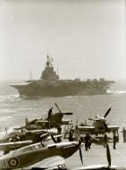 Asisbiz HMS Indefatigable foreground during Malta convoy Operation Pedestal Aug 1942 AWM A15957