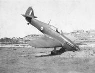 Asisbiz Hawker Hurricane IIb RAF Z4941 taxied into a bomb crater in Malta 01