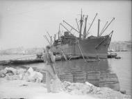 Asisbiz Merchant ship Orari freight being emptied in Grand Harbour Malta 16th Jun 1942 IWM A10417