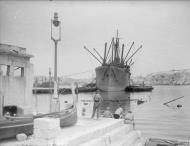 Asisbiz Merchant ship Orari freight being emptied in Grand Harbour Malta 16th Jun 1942 IWM A10418