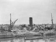 Asisbiz Merchant ship Troilus behind dry dock no4 Grand Harbour Malta 16th Jun 1942 IWM A10410