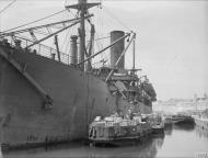 Asisbiz Merchant ship Troilus freight being emptied in Grand Harbour Malta 16th Jun 1942 IWM A10407