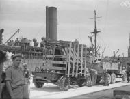 Asisbiz Merchant ship Troilus freight being emptied in Grand Harbour Malta 16th Jun 1942 IWM A10409