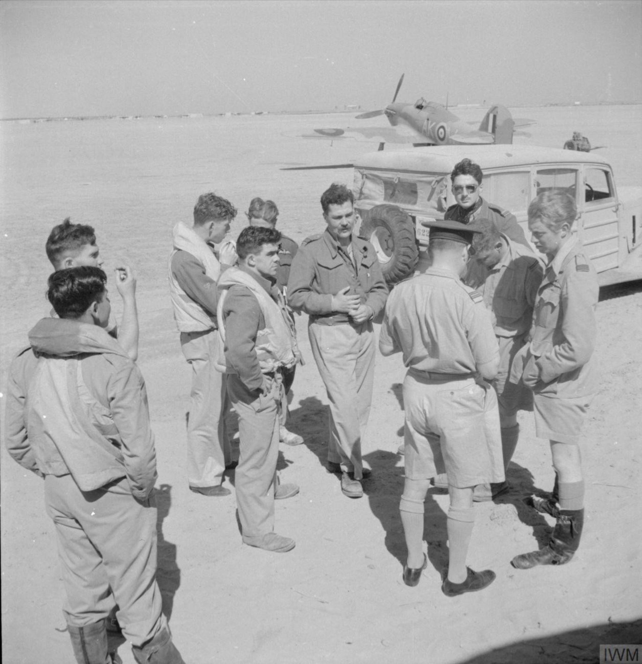Hawker Hurricane IIb Trop RAF 213Sqn AKW are debriefed at Idku Egypt after a sortie IWM CBM1293