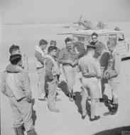 Asisbiz Hawker Hurricane IIb Trop RAF 213Sqn AKW are debriefed at Idku Egypt after a sortie IWM CBM1293