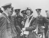 Asisbiz Aircrew RAF ace James Ginger Lacy accepts congratulations from teammates 01
