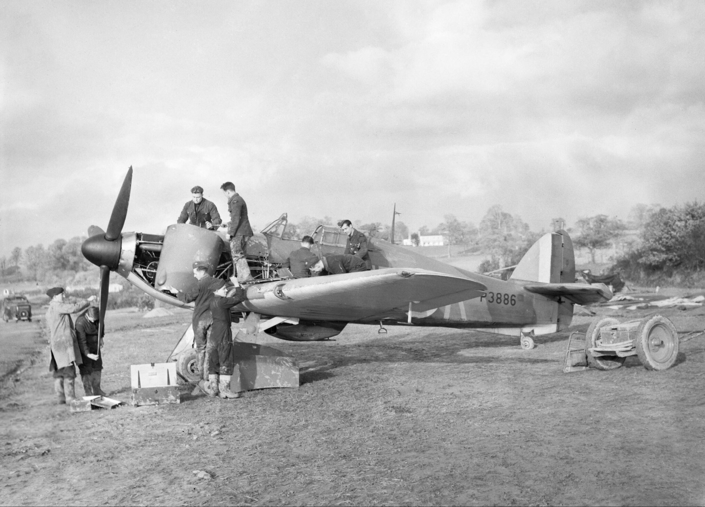 Hurricane I RAF 601Sqn UFK P3886 previously flown by HJ Riddle being repaired at RAF Exeter 1940 IWM C1638