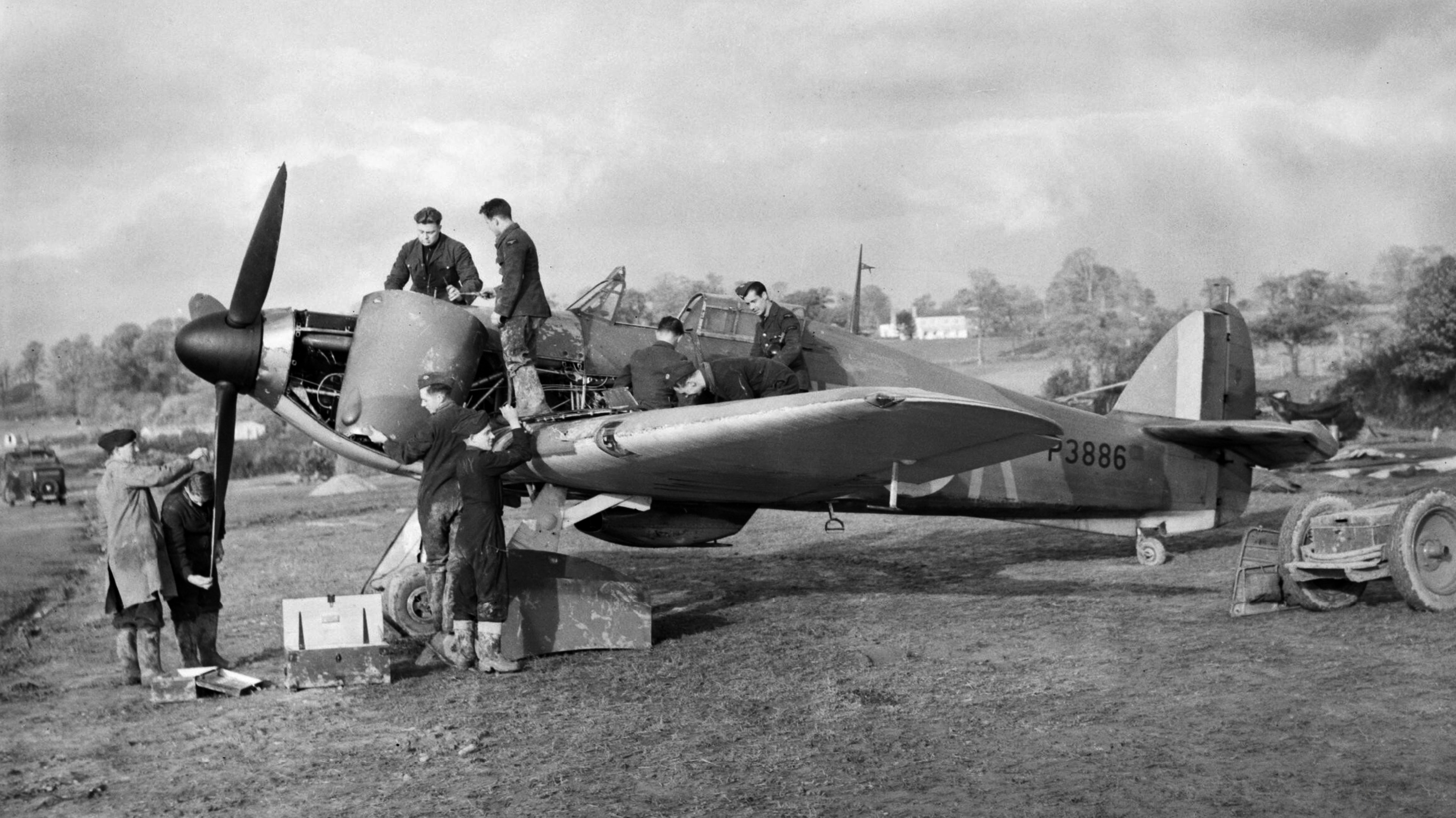 Hurricane I RAF 601Sqn UFK P3886 previously flown by HJ Riddle being repaired at RAF Exeter 1940 IWM C1638a