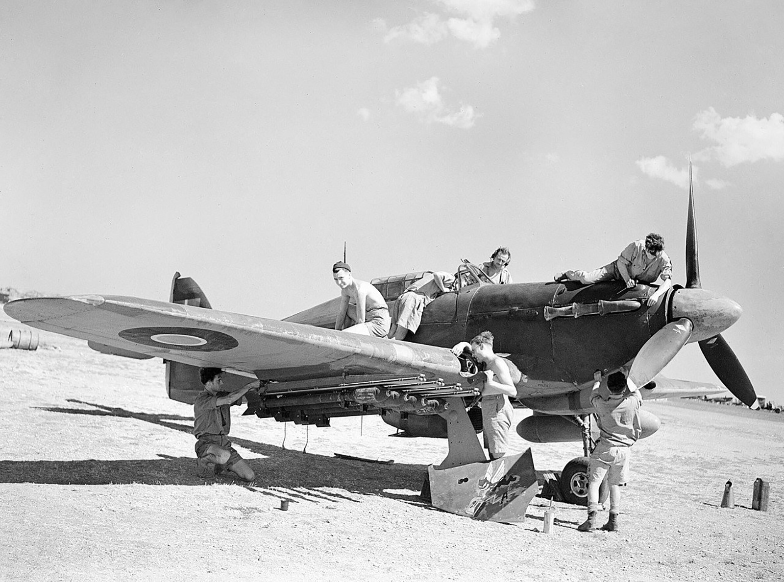 Hawker Hurricane IV RAF 6Sqn being serviced on an airfield in Italy probably Foggia 01