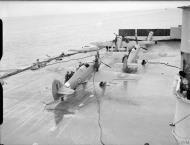 Asisbiz Fleet Air Arm 885NAS Sea Hurricane Red 7L being refueled aboard HMS Victorious IWM A10225