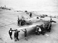 Asisbiz Fleet Air Arm Sea Hurricane Red C AP562 being pushed back prior to launch IWM A10228
