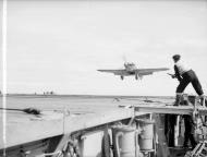 Asisbiz Fleet Air Arm Sea Hurricane landing aboard HMS Avenger 27th Jun 1942 IWM A10979