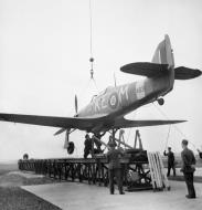Asisbiz MSFU Sea Hurricane I KEM Z4936 being lowered onto a training catapult at Liverpool IWM 01