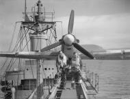 Asisbiz MSFU Sea Hurricane aboard CAM ship SS Empire Tide at Hvalfjord Iceland 14th Jun 1942 IWM A10112