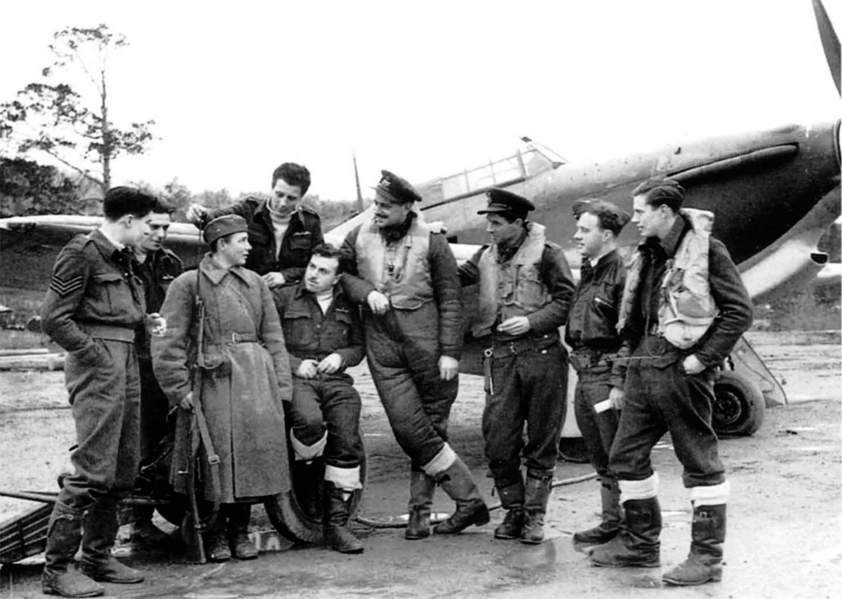 Aircrew from RAF 151 Wing flurting with a lady guard who is some what out numbered Vaenga 1941 01