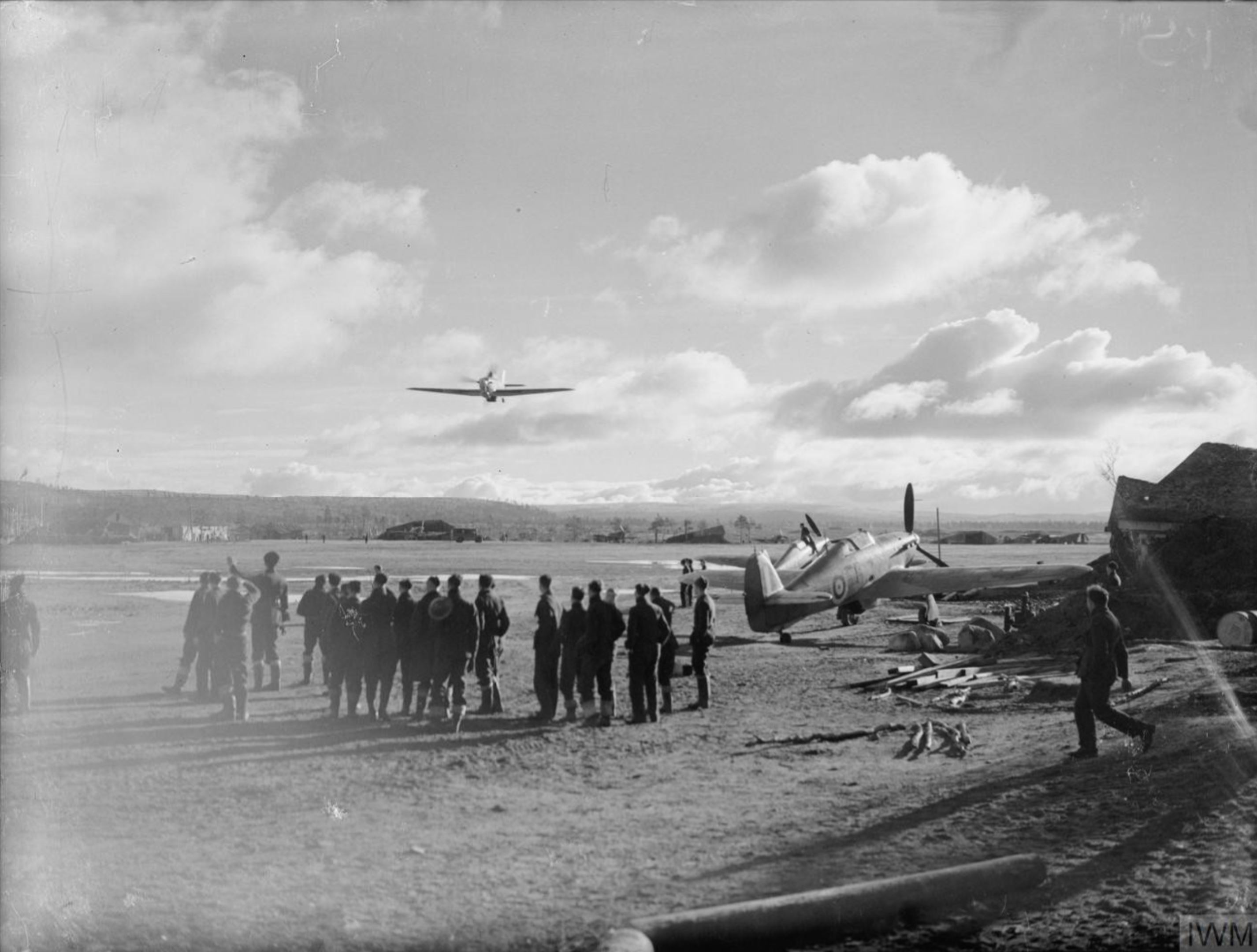 Aircrew from RAF 151 Wing watch a low level pass Vaenga USSR 1941 IWM CR59