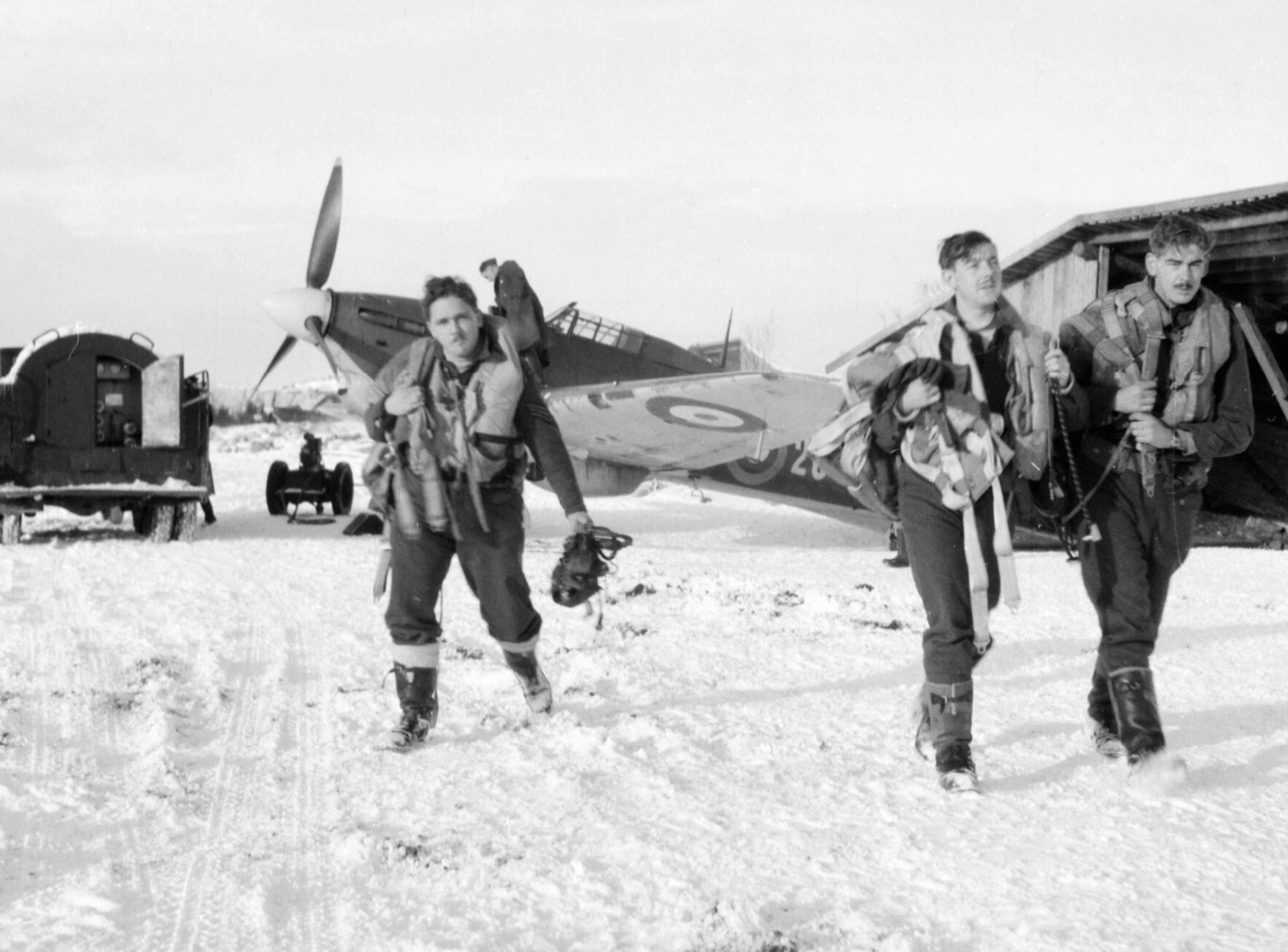 Hurricane IIb RAF 151 Wing 134Sqn aircrew walk towards their aircraft Vaenga USSR Oct 1941 IWM CR60