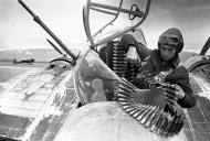 Asisbiz Ilyushin IL 4T 24MTAP being loaded with 12.7mm ammunition by machine gunner radio operator 01