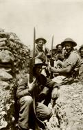 Asisbiz A group of British soldiers in a trench with fixed bayonets IWM E3025E