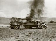Asisbiz British lorry and trailer burning after being attacked by Luftwaffe aircraft 25 June 1941 IWM E3142E