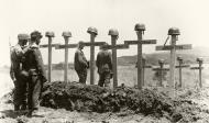 Asisbiz German soldiers pause before the graves of their comrades Bundesarchiv