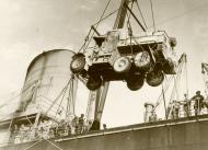 Asisbiz Reinforcing Crete MT being disembarked from a transport note Greek civilian labourers on deck IWM E1167