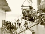 Asisbiz Reinforcing Crete MT being disembarked from the warship IWM E1161