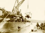 Asisbiz Reinforcing Crete scene on the quayside as the warship was disembarking men and material IWM E1157