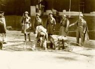 Asisbiz Reinforcing Crete scene on the quayside on the arrival of some of the British troops IWM E1173