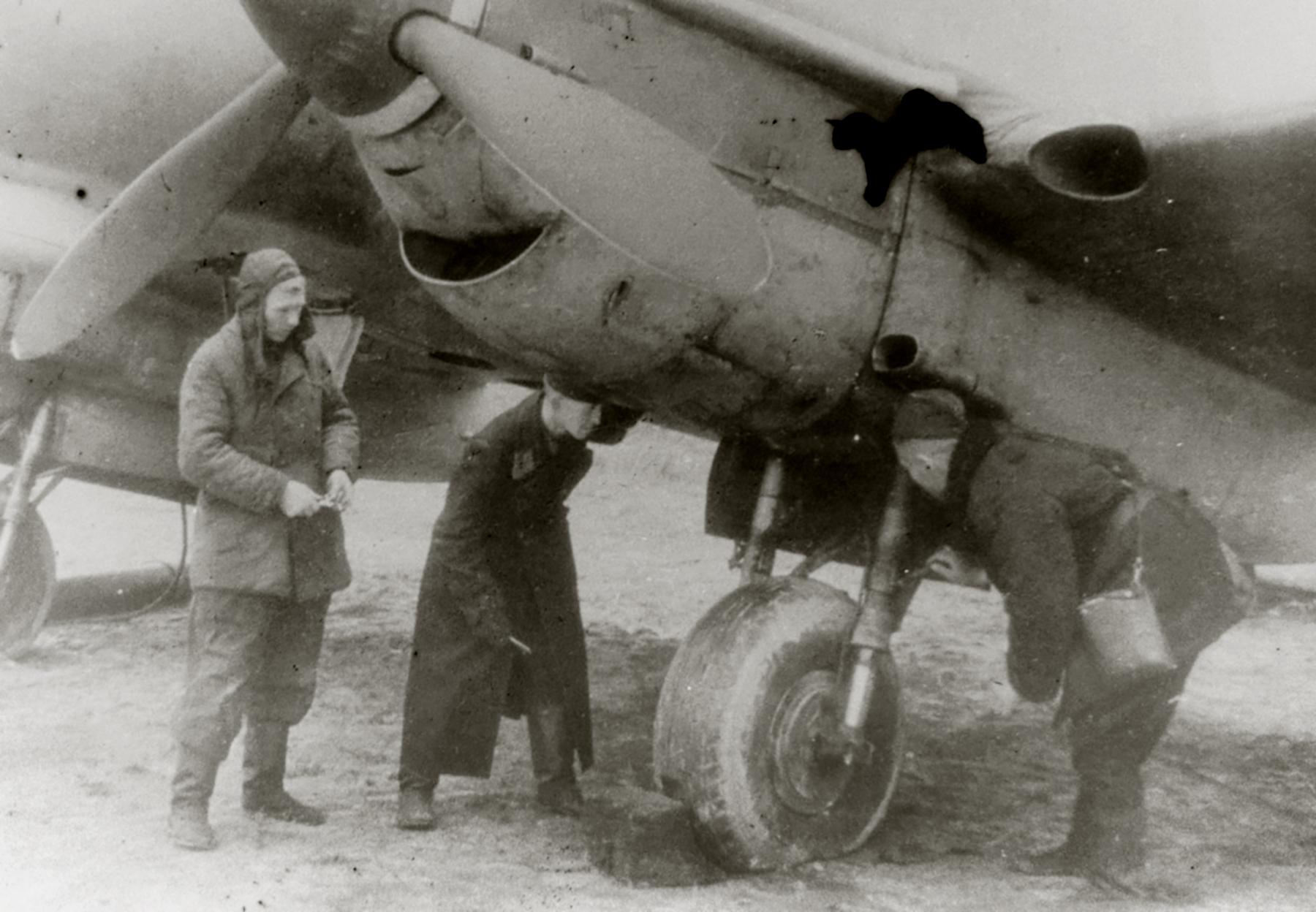 Petlyakov Pe 2 48GAPDr aircraft having its landing gear inspected 01