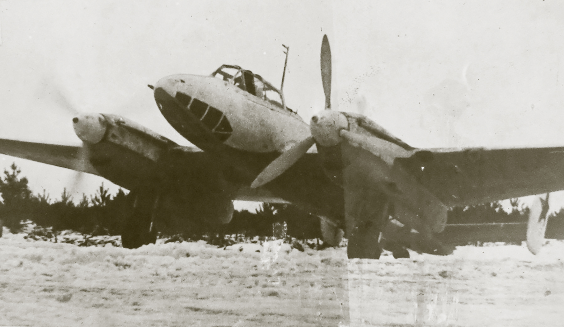 Petlyakov Pe 2 48GAPDr in winter camouflage prepares for its next mission 01