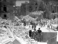 Asisbiz Heavily bomb damaged street in Valletta Malta 1st May 1942 01