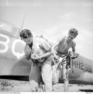 Asisbiz Spitfire LFIX RAF 451Sqn BQA NH269 FSgt CG Ball at St Catherines Calvi Corsica France July 1944 AWM MEA1947