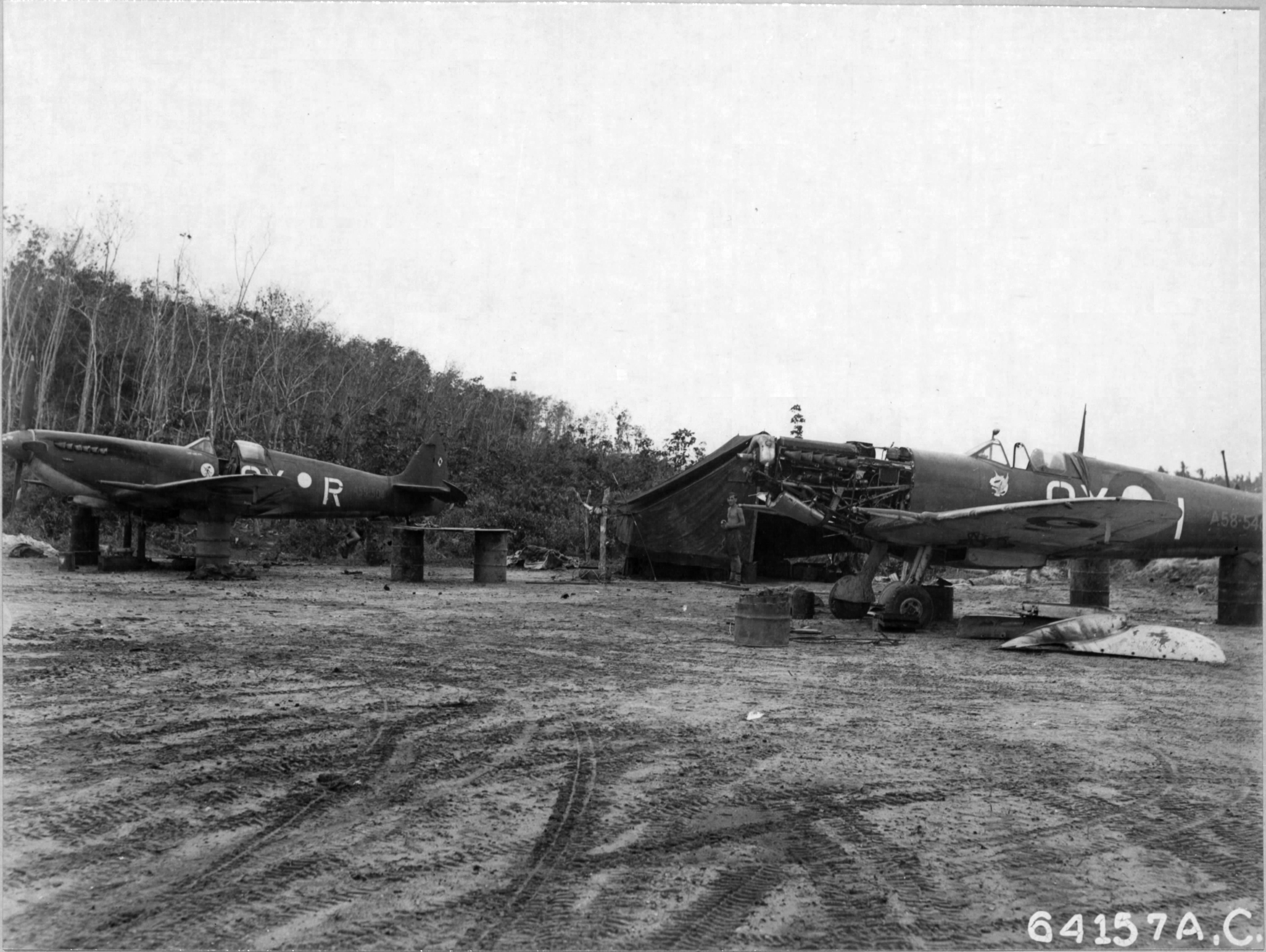 Spitfires MkVIII RAAF 452Sqn QYR and QYI at dispersal area on Sepingang Bali 5th Aug 1945 0
