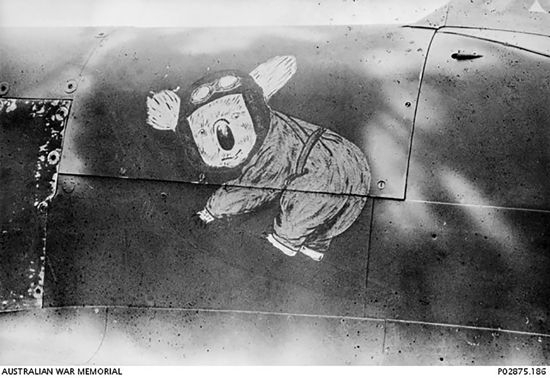 Spitfire MkVc RAAF 79Sqn Koala nose art at Kiriwina Trobriand Islands PNG Sep 1943 IWM 01