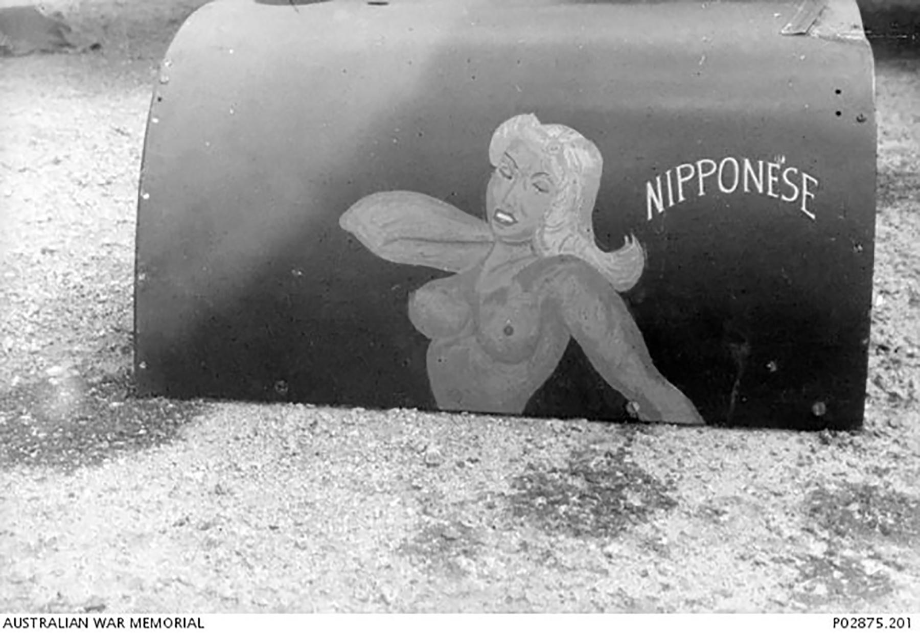 Spitfire MkVc RAAF 79Sqn Nipponese nose art at Kiriwina Trobriand Islands PNG Sep 1943 IWM 01