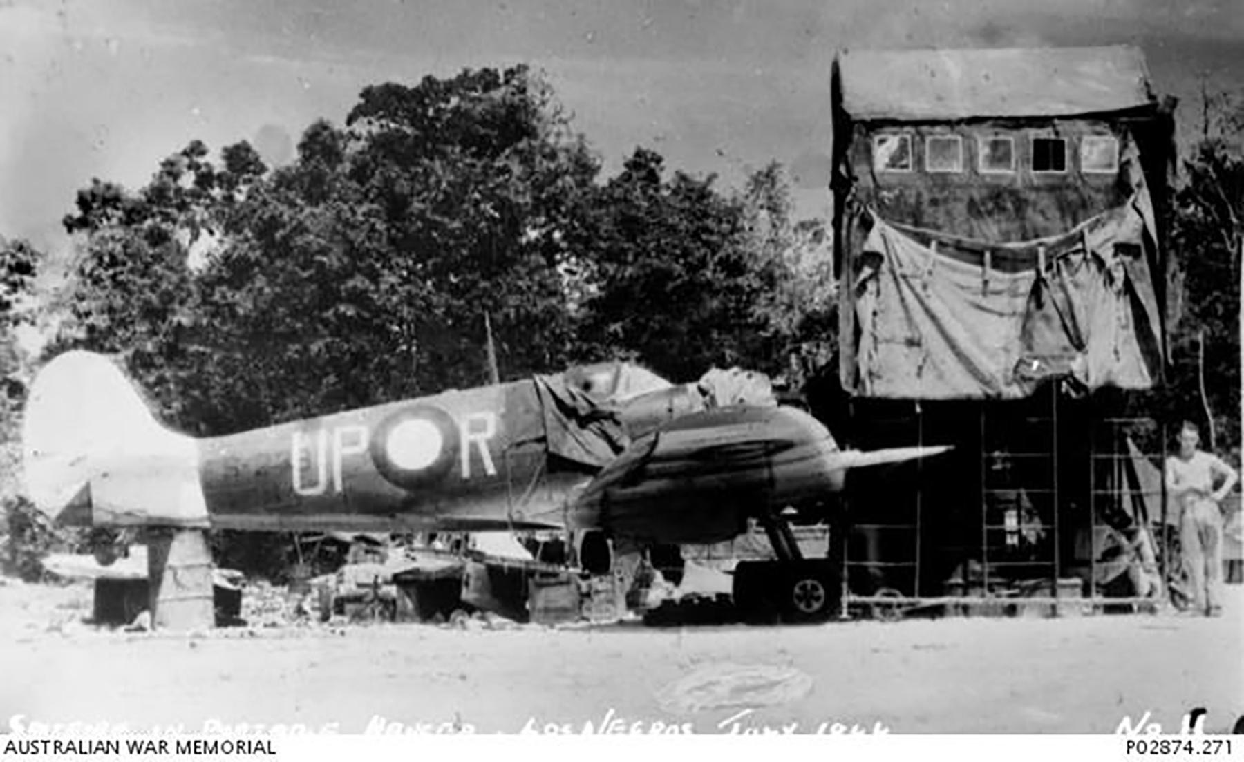 Spitfire MkVc RAAF 79Sqn UPR A58 166 undergoing major maintenance Los Negros IWM 01
