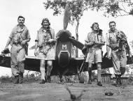Asisbiz Spitfire MkVcTrop RAF 54Sqn DLM SLdr EM Gibbs with Cavanagh Norwood and Thompson Australia late 1943 01