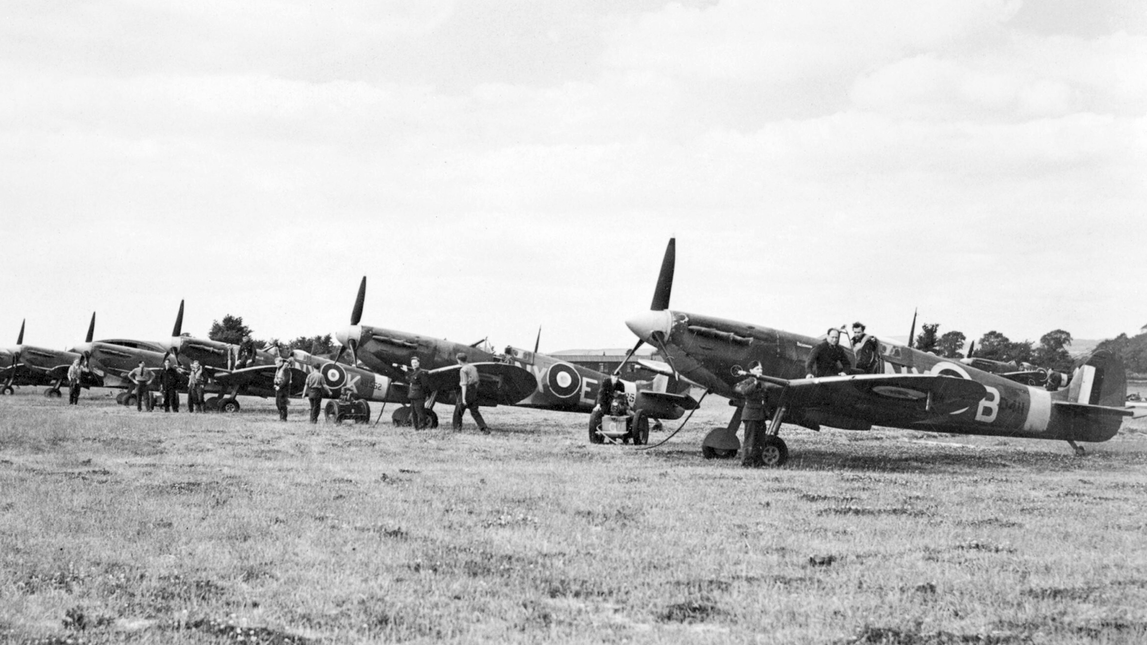 Spitfire MkVb RAF 131Sqn NXB AD411 NXE and NXK at Merston Sussex IWM CH5879a