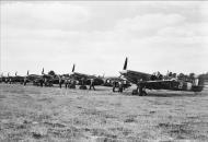 Asisbiz Spitfire MkVb RAF 131Sqn NXB AD411 NXE and NXK at Merston Sussex IWM CH5879