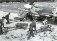 Asisbiz Spitfire MkIX RAF 132Sqn FF being loaded with 2x250 1x500 01