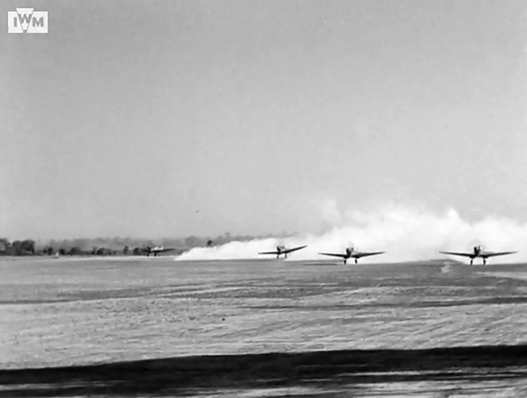 Spitfire VIII RAF 136Sqn in line abreast formation taking off from Rumkhapalong Bangladesh CBI 1944 IWM 01