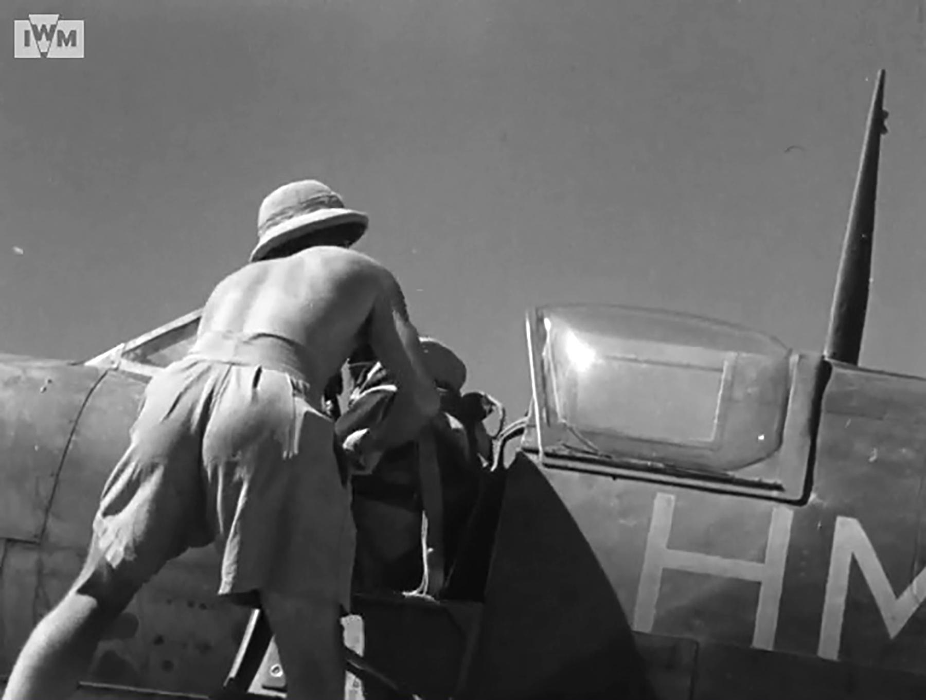Spitfire VIII RAF 136Sqn pilot being strapped in before taking off from Rumkhapalong Bangladesh CBI 1944 IWM 01