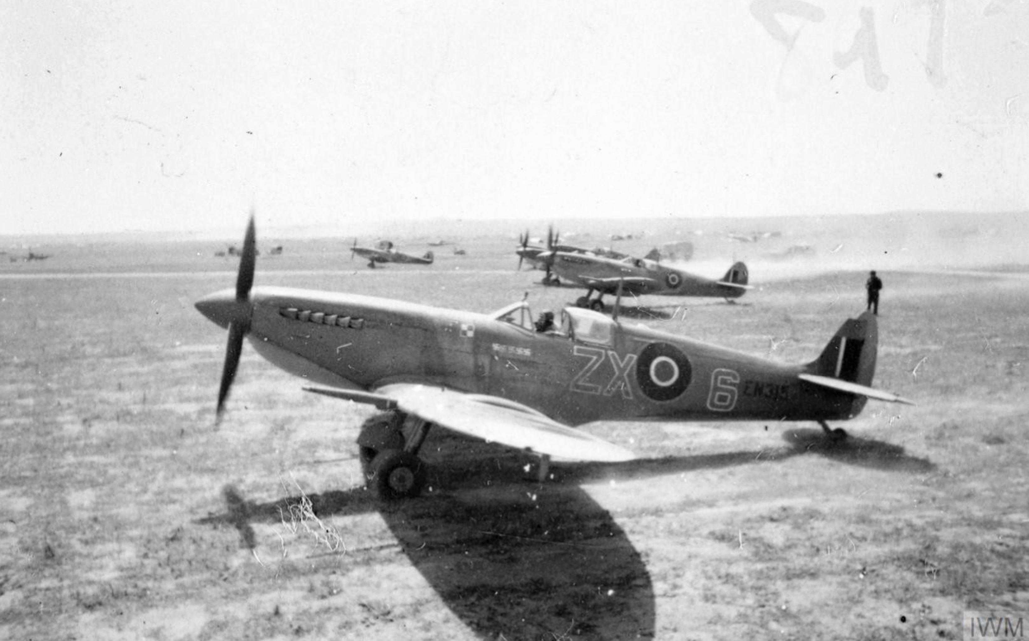 Spitfire MkIXc RAF 145Sqn ZX6 EN315 Stanislaw Skalski and EN261 dispersal area at Tunisia Apr 1943 IWM CNA4542