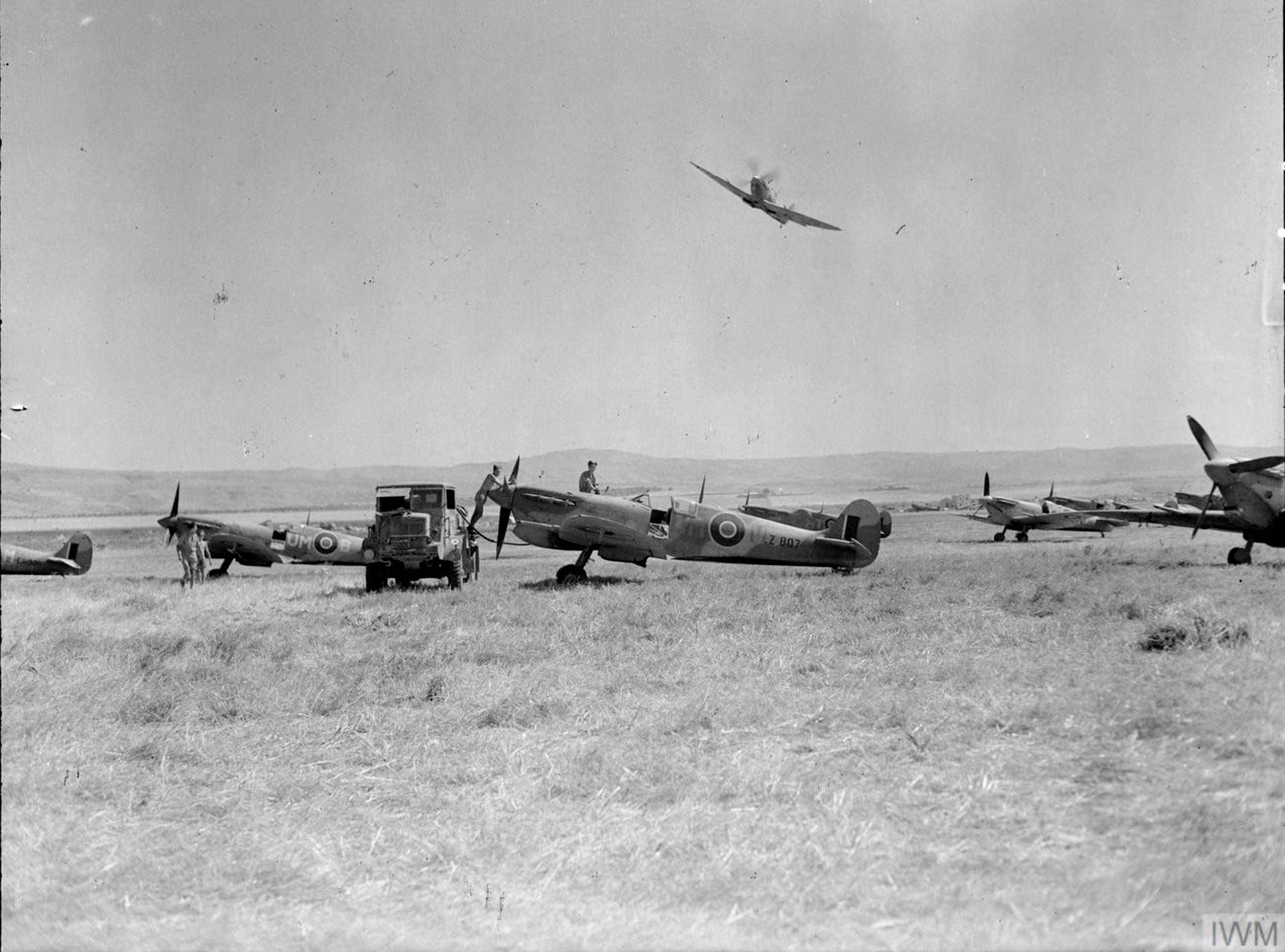 Spitfire MkVcTrop RAF 152Sqn UMV LZ807 UMB and UMM being refuelled at Lentini East Sicily 1943 IWM CNA1130