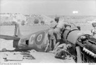 Asisbiz Spitfire IX RAF 154Sqn HTC EN356 being salvaged Malta Jul 1943 AWM MEC2032