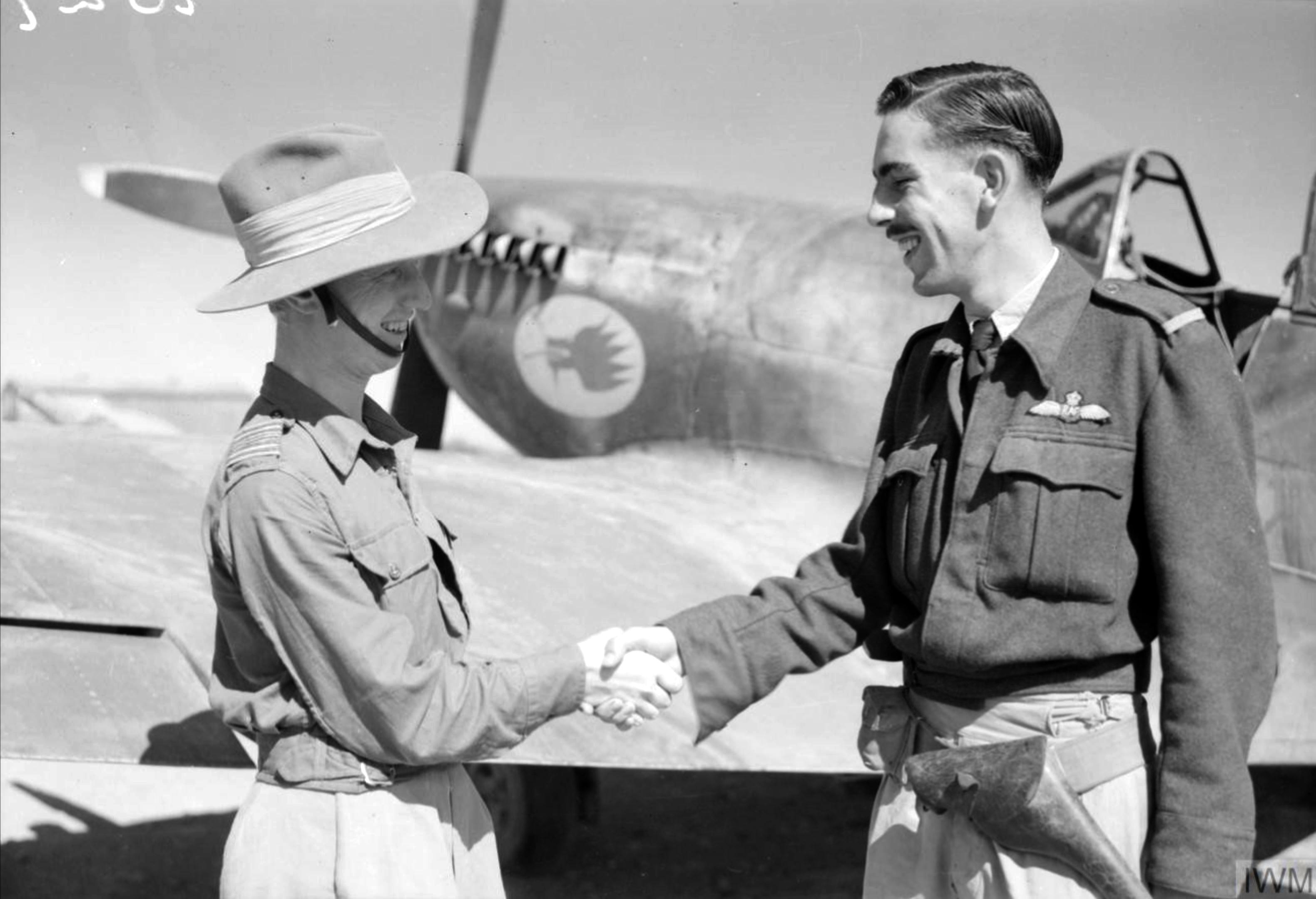 Aircrew RAF 17Sqn Ginger Lacey CO congratulates D Witteridge at Sapam Burma IWM CF199