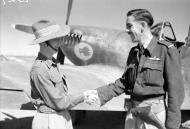 Asisbiz Aircrew RAF 17Sqn Ginger Lacey CO congratulates D Witteridge at Sapam Burma IWM CF199